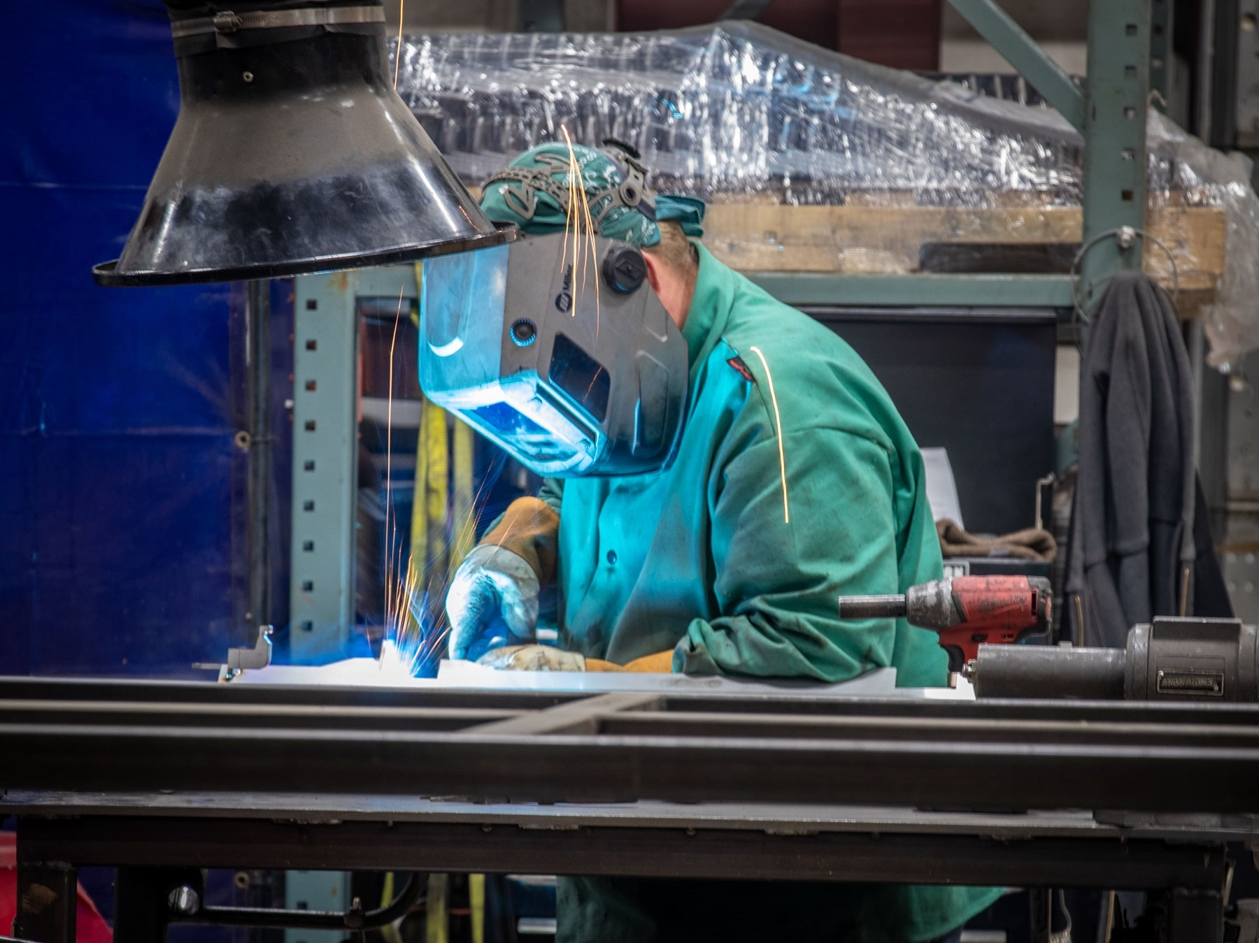 welder at work in steel green manufacturing facility